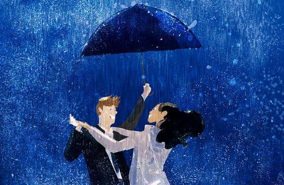 빗 속에서 우산을 쓰고 춤 추는 연인