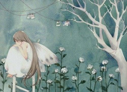 꽃밭에 앉아있는 소녀
