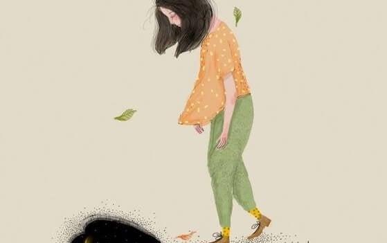 바닥을 보며 걷는 여자