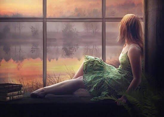 창밖을 보는 여자